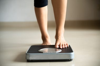 feet on a weight scale