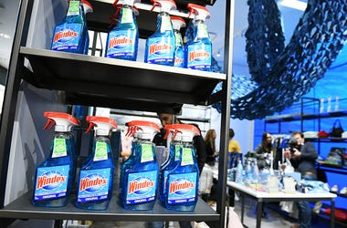 multiple bottles of windex window cleaner