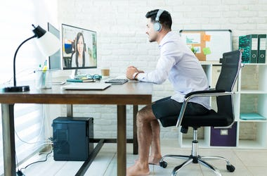 man at desk working at home in shorts