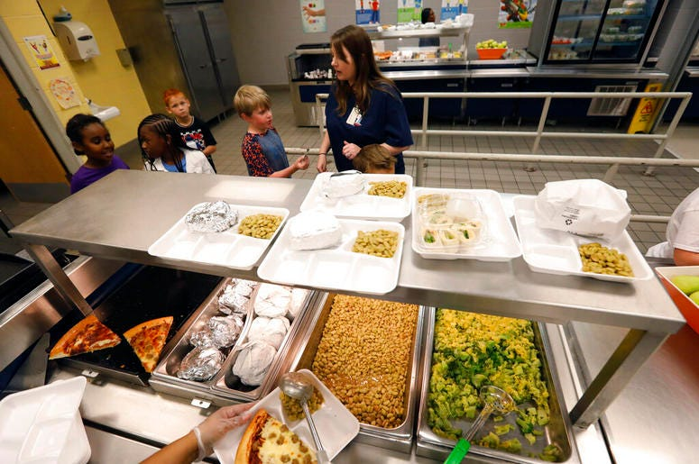 A teacher lines up the students for school-prepared lunches at Madison Crossing Elementary School in Canton, Miss., Friday, Aug. 9, 2019. Scott Clements, director of child nutrition at the Mississippi education department, said they've ordered two trucklo