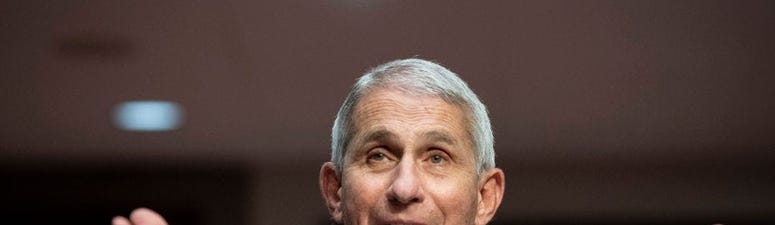 Fauci warns early COVID vaccines will prevent symptoms, not block infection
