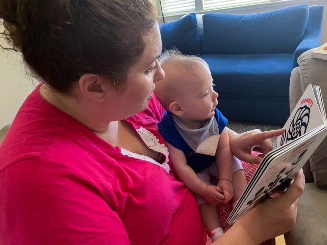 Kristen reading to Lilly