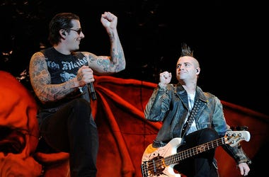 Avenged Sevenfold singer M. Shadows (L) and bassist Johnny Christ perform during the 48 Hours Festival October 15, 2011 in Las Vegas, Nevada