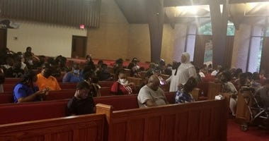 Residents hoping to cast ballots wait inside New Life Presbyterian Church in Atlanta Tuesday
