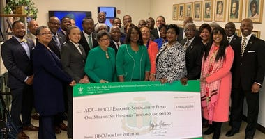 Alpha Kappa Alpha International President Dr. Glenda Glover presents a check to HBCU representatives in 2019