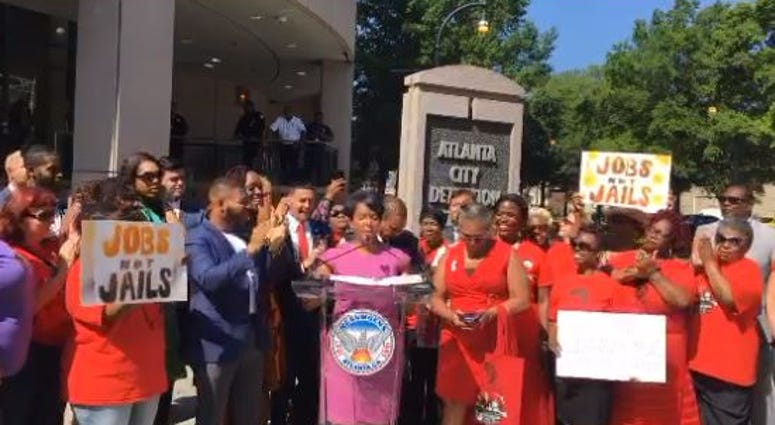 Mayor Keisha Lance Bottoms prepares to sign legislation to close the Atlanta jail