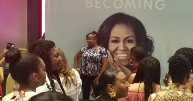 "Former first lady Michelle Obama talked about her life during ""Becoming"" book tour event in Atlanta"