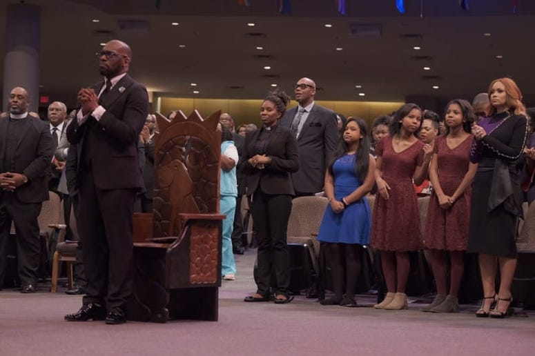 Bryant's ex-wife and their 3 daughters sit behind him during Sunday evening's Installation Service