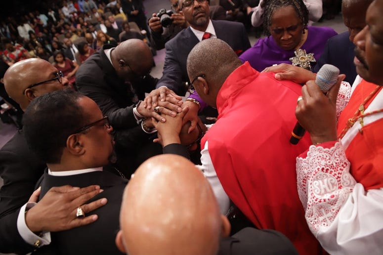 """Faith leaders participating in the """"Laying of Hands"""" during the Installation Service for Dr. Jamal Bryant"""