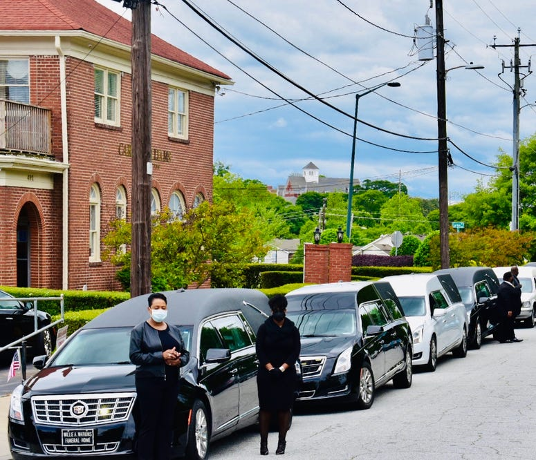 Funeral procession prepares to leave funeral home in southwest Atlanta to protest the reopening of Georgia during the COVID-19 pandemic