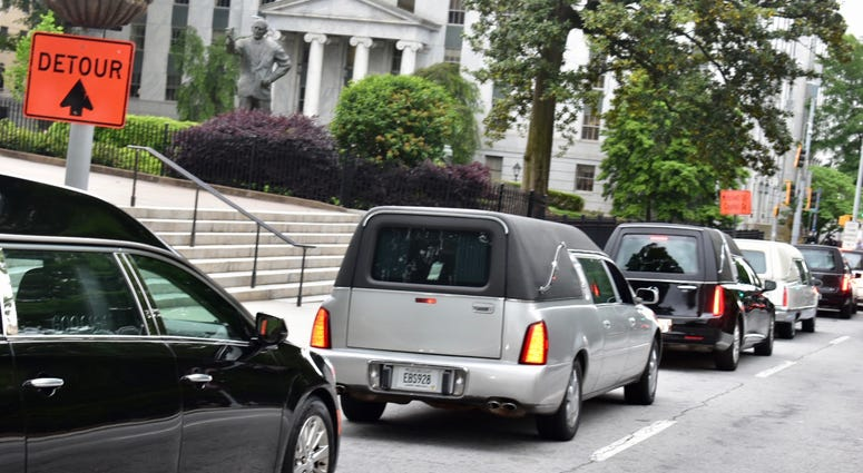 """Hearses from various Atlanta funeral homes were at the GA Capitol Thursday to protest """"reopening of Georgia"""" during the COVID-19 pandemic"""
