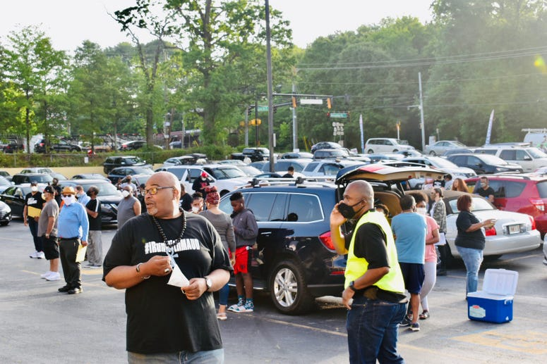 WAOK show host Derrick Boazman is among participants gathered for the caravan to Brunswick, GA