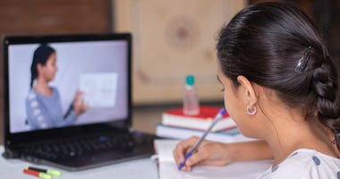 Advice from parent on managing at-home teaching aide role: Be patient, take breaks