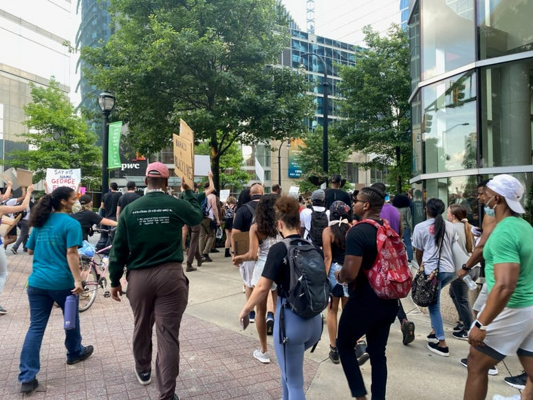"Protesters chanted ""Black Lives Matter Too"" as they walked down Peachtree Street in Atlanta Tuesday."