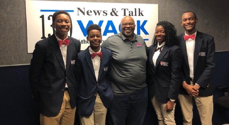 Derrick Boazman with members of the Harvard Diversity Project Debate Team