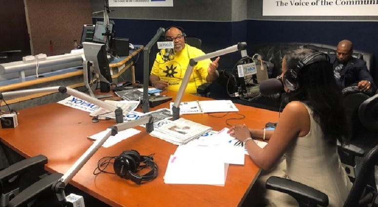 Derrick Boazman with Fulton County Commissioner Natalie Hall in WAOK Studios 9/30/19