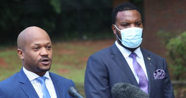 Attorneys for Ahmaud Arbery's family, Chris Stewart (l) and Lee Merritt (r) address an Atlanta news conference calling for 'justice' in the case.