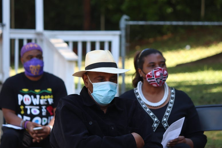 """During Tuesday's news conference in Atlanta, Reverend Doctor Gerald Durley (white hat), founder of the Concerned Black Clergy of Atlanta, called Ahmaud Abery's death """"immoral"""" and """"unethical."""""""