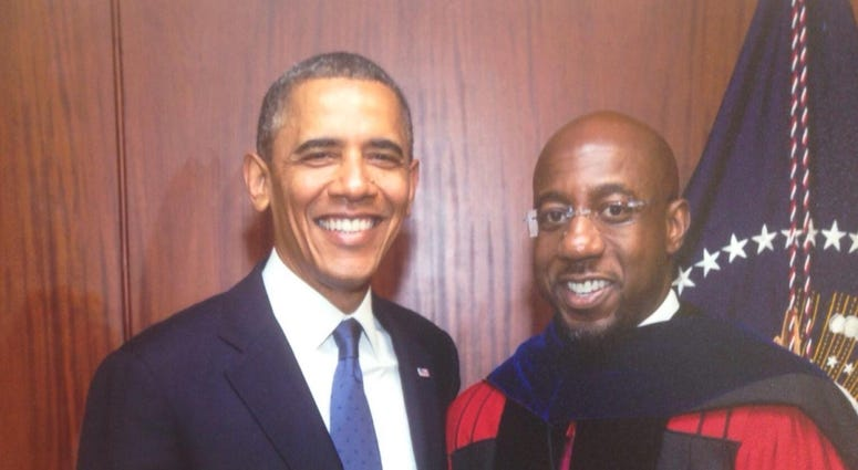 Former President Obama is shown in a photo with candidate for U.S. Senate Dr Raphael Warnock
