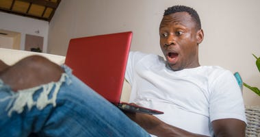 Surprised man at computer