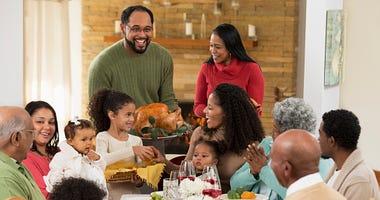Family eating Thanksgiving dinner.