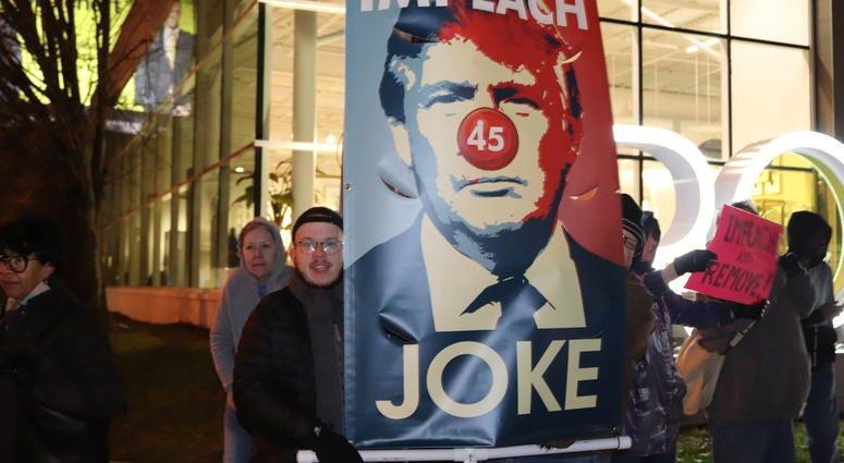 Protestors Demand Sen. David Perdue look at the evidence in Trump's impeachment