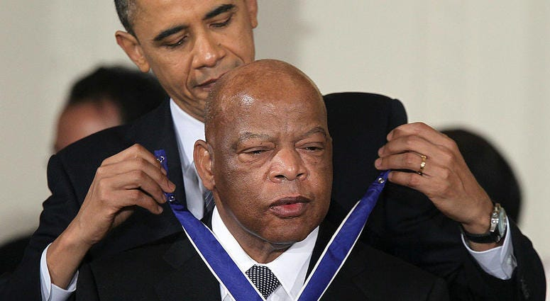 Congressman John Lewis receives the Congressional Medal of Freedom from then-President Barack Obama on February 15, 2011 at the White House