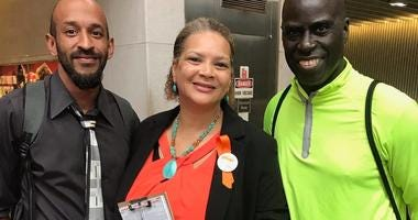 Joel Caldwell (l) and Deborah Scott (m) with GA StandUp, and Hank Stewart (r), President of the Stewart Foundation, during voter registration event at the 5 Points MARTA station in Atlanta GA.