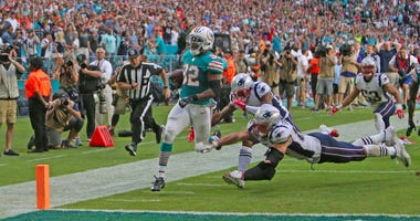 Kenyan Drake crossing goal line Miami Miracle