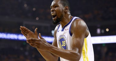 Kevin Durant #35 of the Golden State Warriors reacts during their game against the Houston Rockets in Game Five of the Western Conference Semifinals of the 2019 NBA Playoffs at ORACLE Arena on May 08, 2019 in Oakland, California.