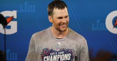 Tom Brady of the New England Patriots smiles at his press conference after Super Bowl LIII.
