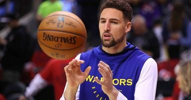 Klay Thompson of the Golden State Warriors warms up before Game 2 of the NBA Finals.