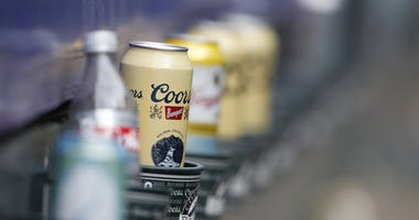 Molson Coors Brewing Co. is laying off 500 workers worldwide and restructuring its operations as it faces declining beer sales.
