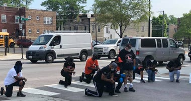 Students from Leo Catholic High School in the Auburn-Gresham neighborhood on Chicago's South Sidecleanedup 79th Street on Thursday, following several days of property damage and looting.