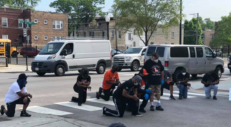 Students from Leo Catholic High School in the Auburn-Gresham neighborhood on Chicago's South Side cleaned up 79th Street on Thursday, following several days of property damage and looting.