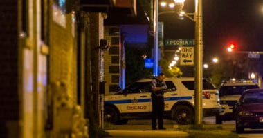 Chicago police investigate a 11-year-old who was found dead inside a home Monday morning in the 900 block of West 119th Street.