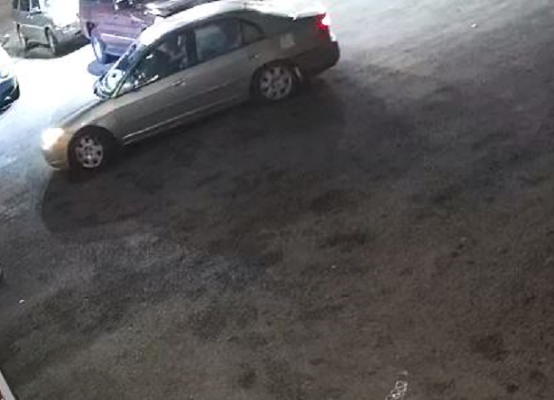 Surveillance footage vehicle driven by males wanted in strong-armed robbery.