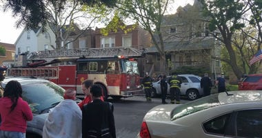 American Red Cross volunteers assist residents displaced by a house fire May 15 in the 6900 block of South King Drive.