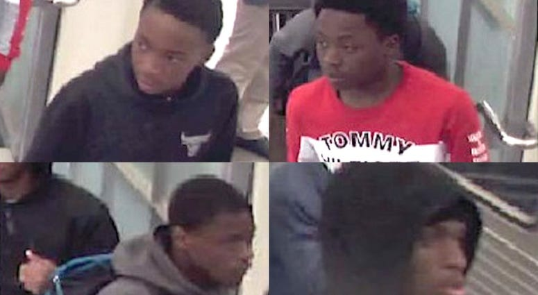 Police say four males are wanted for robbing people on the Red Line.