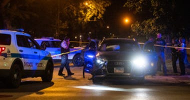 Chicago police investigate the scene of a multi-vehicle crash involving a police squad car, Friday night, in the 8100 block of South Jeffery, in the South Chicago neighborhood.