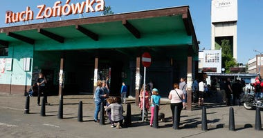 Families waiting for a word about miners who have gone missing after a tremor at the Zofiowka coal mine in Jastrzebie-Zdroj in southern Poland, on Saturday, May 5 , 2018.