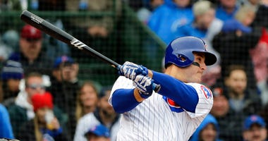 Chicago Cubs' Anthony Rizzo hits a three-run home run against the Chicago White Sox during the first inning of a baseball game Saturday, May 12, 2018, in Chicago.
