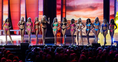 In this Sept. 13, 2015, file photo, contestants wear swimsuits as they compete in the 2016 Miss America pageant in Atlantic City, N.J. The Miss America Organization is dropping the swimsuit competition from its nationally televised broadcast, saying it w