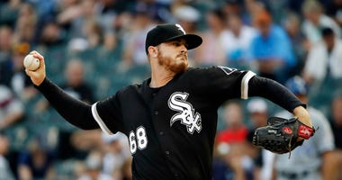 Chicago White Sox starting pitcher Dylan Covey throws against the Kansas City Royals during the first inning of a baseball game Saturday, Aug. 18, 2018, in Chicago. (AP Photo/Nam Y. Huh)