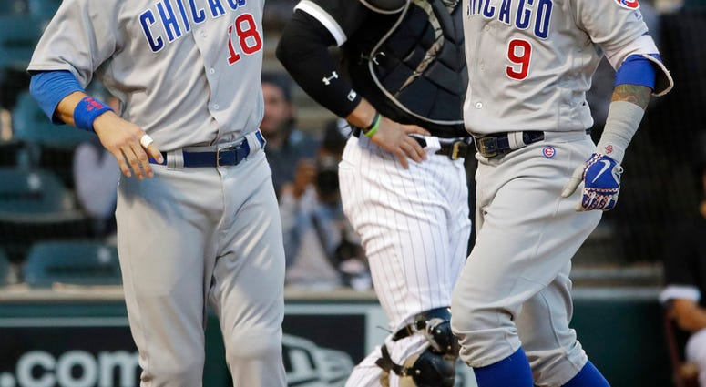 Chicago Cubs' Javier Baez, right, celebrates with Ben Zobrist after hitting a two-run home run against the Chicago White Sox during the first inning of a baseball game Saturday, Sept. 22, 2018, in Chicago. (AP Photo/Nam Y. Huh)
