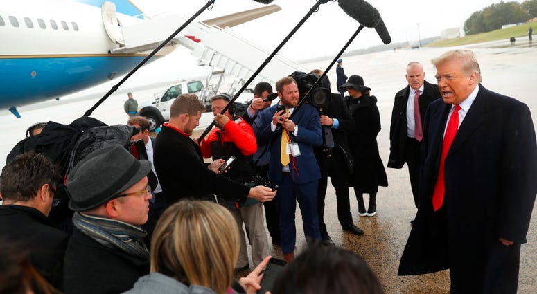 President Donald Trump speaks to the media at Air Force One at Andrews Air Force Base, Saturday, Oct. 27, 2018, before travelling to Indianapolis to speak at the 91st Annual Future Farmers of America Convention and Expo. (AP Photo/Andrew Harnik)