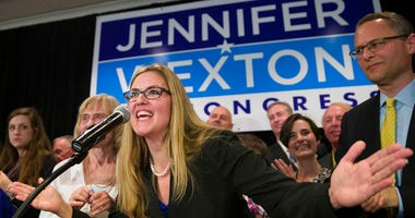 Democrat Jennifer Wexton speaks at her election night party after defeating Rep. Barbara Comstock, R-Va., Tuesday, Nov. 6, 2018, in Dulles, Va. (AP Photo/Alex Brandon)