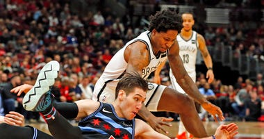 Brooklyn Nets forward Ed Davis, and Chicago Bulls guard Ryan Arcidiacono (51), go for a loose ball during the second half of an NBA basketball game Sunday, Jan. 6, 2019, in Chicago. (AP Photo/Nuccio DiNuzzo)