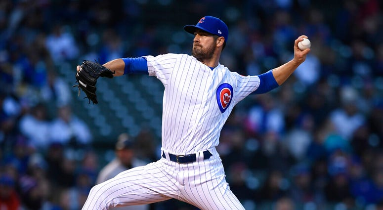 Chicago Cubs starter Cole Hamels delivers a pitch during the first inning of a baseball game against the Miami Marlins, Monday, May 6, 2019, in Chicago.