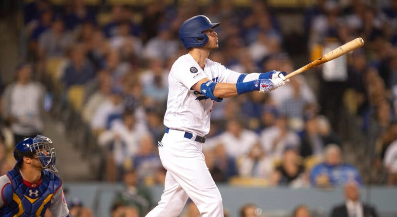 Los Angeles Dodgers' Cody Bellinger watches his two-run home run during the fourth inning of a baseball game against the Chicago Cubs in Los Angeles, Thursday, June 13, 2019.